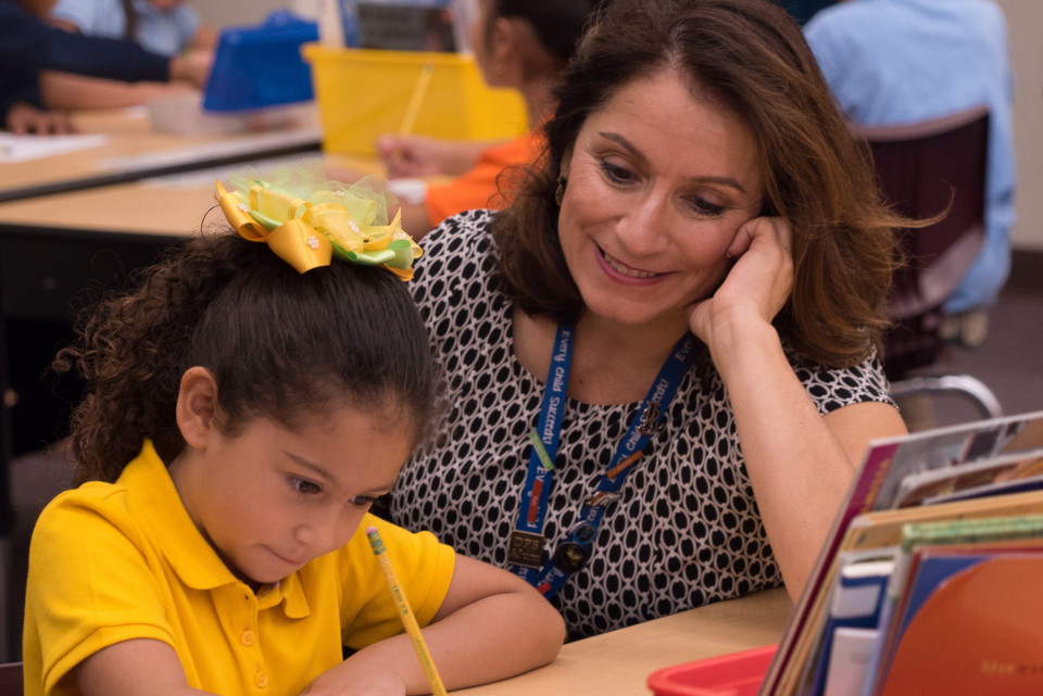 Superintendent Susana Cordova with a student in a classroom
