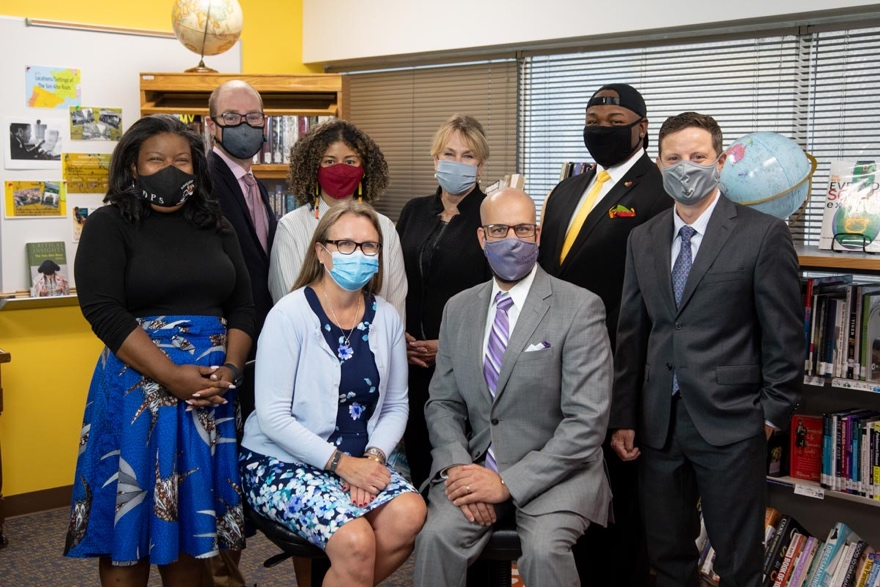 Members of the Denver Board of Education pose for a group photo with Superintendent Alex Marrero, all wearing masks.